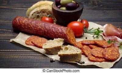 salami or chorizo sausage close up on a wood board or table