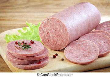 Salami sausage on wooden cutting board