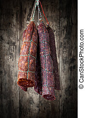 salami sausages on a wooden background