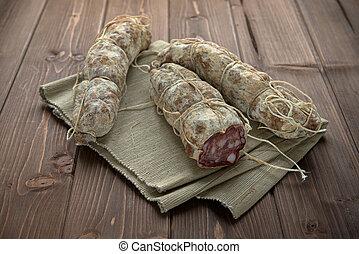 Seasoned taste sausage on the wood table