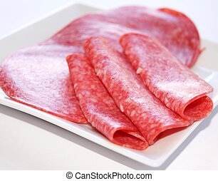 salami slices on a plate