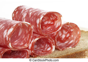 Salami slices rolled on bread