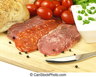 Salami slices with cottage cheese, tomatoes and bread