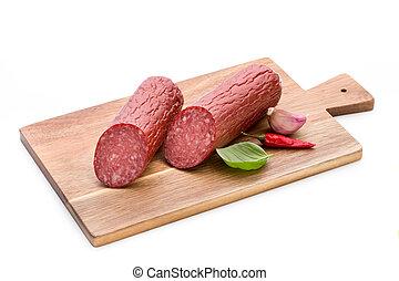 Salami smoked sausage, basil leaves on white background...