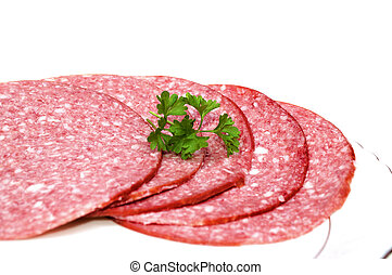 Salami - Slice of salami with parsley isolated