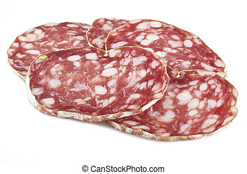 Salami with slices on wood