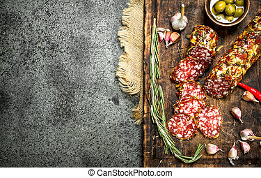 Salami with spices on a cutting board.