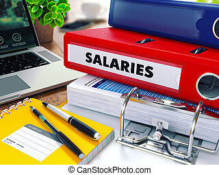 Salaries on Red Ring Binder. Blurred, Toned Image. - ...