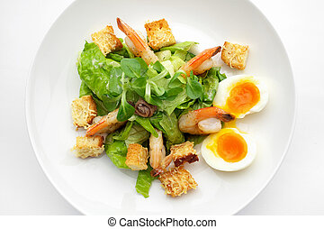 salat with shrimp and eggs. Top view - salat with shrimp and...