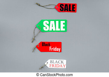 Sale and black friday labels on grey background top view pattern copyspace