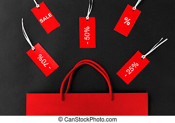 red shopping bag and tags with discount signs