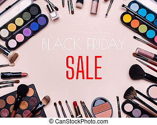 Sale, Black Friday concept. Decorative cosmetics on a pink background