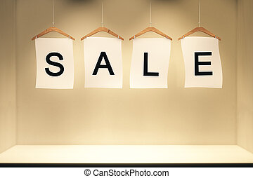 Sale concept labels in empty room