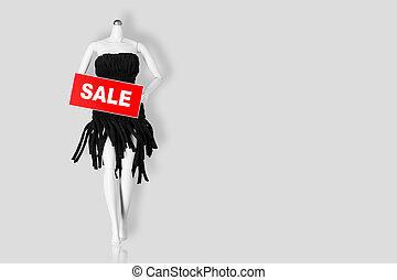 Sale concept. Mannequin holding sale sign isolated on gray background. Copy space