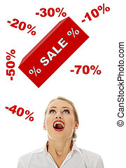 Sale concept - Young woman amazed becouse of sale, isolated...