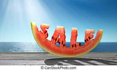 Sale concept - Word SALE carved in a slice of watermelon on...