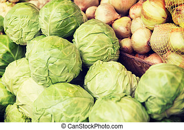 close up of cabbage and onion at street market - sale, ...