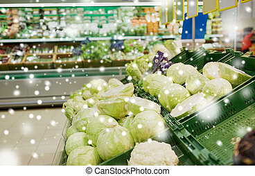close up of cabbage at grocery store or market - sale, ...