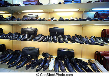 Sale of masculine shoe is in shopping center