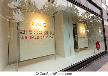 sale poster in the displaywindow of shop