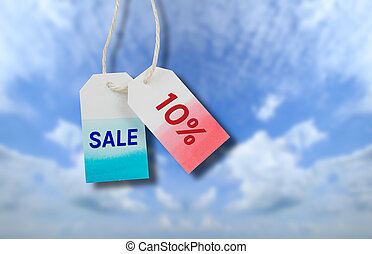 Sale price tag with cloud and blue sky background