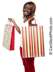 Sale Sale Sale... Woman carrying shopping bags