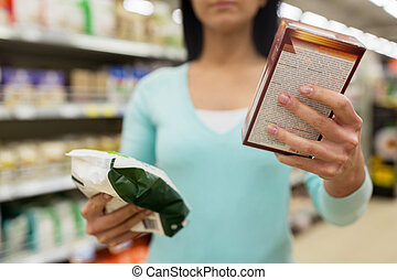 close up of woman with food at grocery store