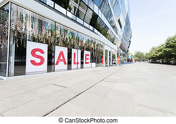 sale sign in shopping mall showcase and empty square