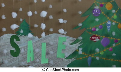Sale Sign new year. against the background of a painted Christmas tree and snow