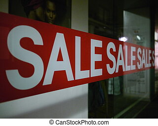 Sale Sign On Glass Window