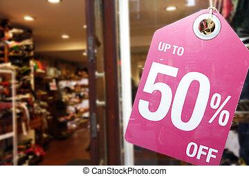 Sale signs in shop window