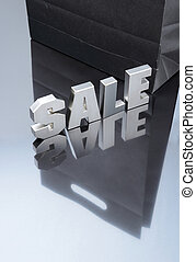 Sale silver text with paper bag