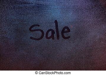 Sale symbol on frozen window
