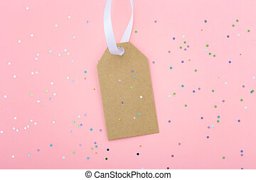 Sale tag on pastel pink background