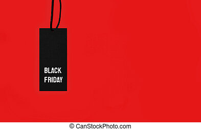 Sale tag with Black Friday inscription on red background.
