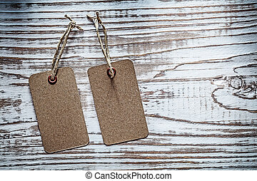 Sale tags on vintage wooden board
