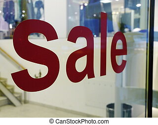 sale text on shopping window