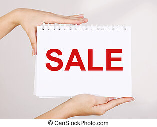 Sale - Woman hands showing sale advertisement ver white...