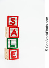 SALE word wooden block arrange in vertical style on white background and selective focus
