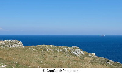 Salento countryside panoramic view panning watchtower coastal seascape grass Apulia Italy