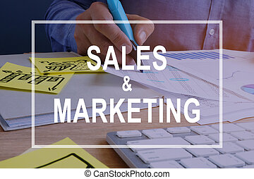 Sales and Marketing concept. Documents on a desk.