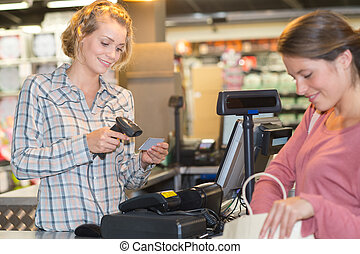 sales assistant working at the check-out