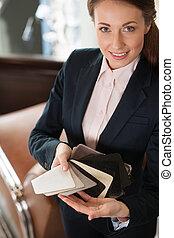 Sales clerk in fabric shop. Beautiful female sales clerk...
