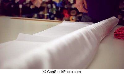Sales clerk works in the tissue store. Sell textile.Textile...