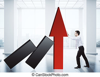Sales growth concept - Businessman holding red chart arrow...