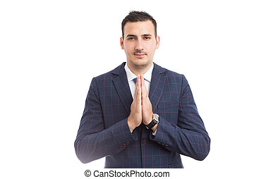 Sales man with palms together praying