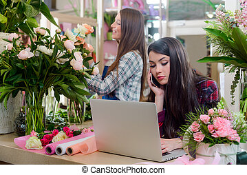 Sales manager consulting a costumer about bouquets