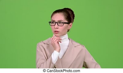 Sales manager reflects on the working moments. Green screen. Slow motion
