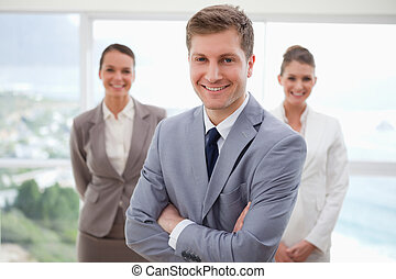 Sales manager standing with arms folded