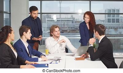 Sales people meeting in office.